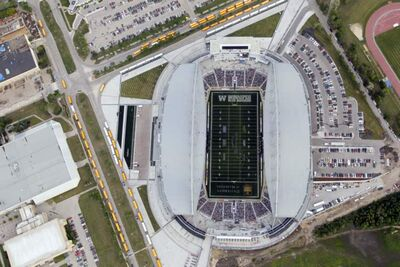 Long rows of buses and full parking areas are seen in an aerial view of Investors Group Field for the first regular-season Bomber game Thursday evening.