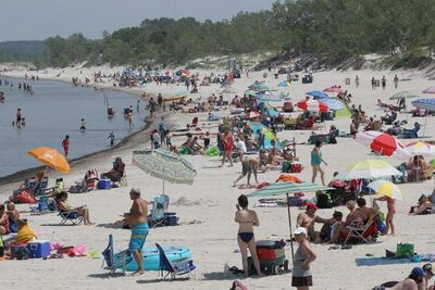 Many people came to cool off at Grand Beach Wednesday afternoon as temperatures soared above 30 C.