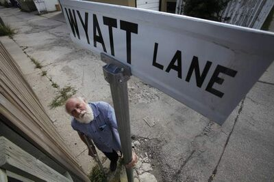 Coun. Harvey Smith 'named' an alley in his ward after deputy mayor Russ Wyatt.