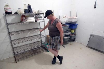 Pam Cavers at the empty shelf that held seized products.
