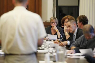 Education Minister Nancy Allan winks at Attorney General Andrew Swan as Peter Wohlgemut presents to the panel.