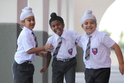 Sikh students (from left) Baljot Singh, Sehaj Singh and Bharjaheen Singh have some fun Thursday outside their school  at the Punjab Cultural Centre on King Edward Street.
