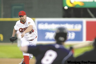 Goldeyes southpaw Bill Pulsipher delivers to Shaumburg Flyers' Tony Mansolino, who was waiting to lay down a bunt.