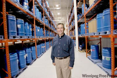 Tony Martinez, vice-president and general manager of Biovail's Steinbach facility, stands in the storage area for bulk tablets they produce.