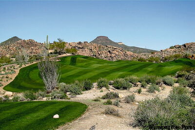 Rolling greens and fairways wind through the Sonoran Desert at Troon North golf course.