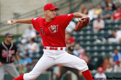 Winnipeg Goldeyes' Pitcher Ace Walker delivers a smoker in the eighth inning of a game in 2010.