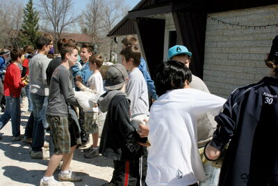 Grade 8 students from Carman Collegiate helped with sandbagging efforts in the RM of Cartier in May 2011.