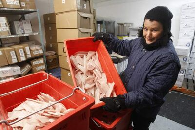 Claudine Kasprick piles on the clothes for work in the Gimli Fish Market freezer.