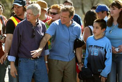 Robin Williams holds back fans during a break in shooting The Big White in Winnipeg in 2004.