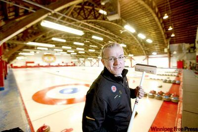 The MCA's Shane Ray surveys the Grain Exchange Curling Club ice. The building will be torn down to make way for the Upper Fort Garry heritage centre.