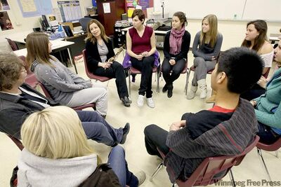 Teacher Marla Pott  joins kids at J.H. Bruns Collegiate in a sharing circle  as part of a native studies course.