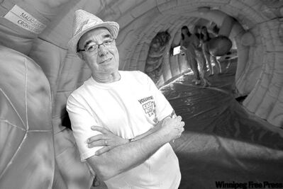 Cancer coach Sid Chapnick in the giant colon at the Ex. The exhibit is meant to  educate people about colorectal cancer and the importance of colonoscopies.