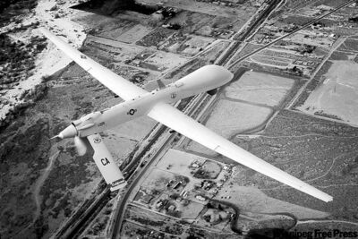 An unmanned drone flies a training mission over Victorville, Calif.