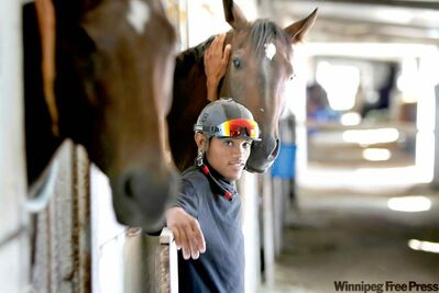 WAYNE GLOWACKI / winnipeg free pressChavion Chow has earned his racing stripes and is no longer an apprentice jockey. Here he relaxes between two of his mounts, Trixie (left) and Hobo Hwy.