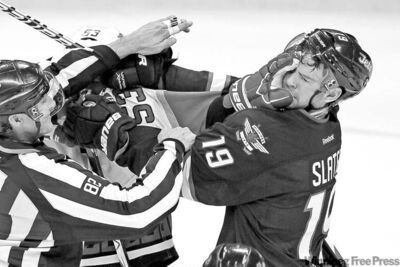John Woods / Winnipeg Free Press archivesJets� Jim Slater (19) and Hurricanes� Jeff Skinner get in each other�s grille last Saturday. Slater isn�t letting a concussion change his game.