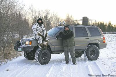 Jay McLeod (left) and Willy intend to explore Northern Manitoba in this 1994 Jeep Grand Cherokee.