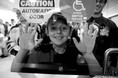 TREVOR HAGAN / WINNIPEG FREE PRESS archives New Jets fan Seth Kohn, 8, waits to entire the MTS Centre for the Jets� first game back in 15 years.