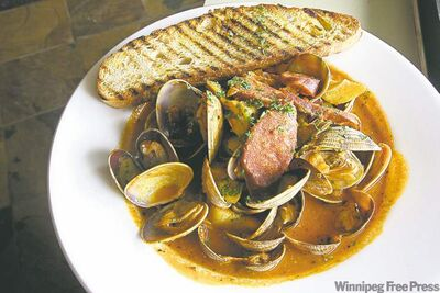 Manila  clams with chorizo  sausage  and artichokes  at Bonfire Bistro  on Corydon Avenue.
