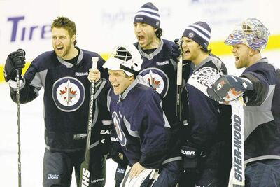 JOE BRYKSA / WINNIPEG FREE PRESSWinnipeg Jets players (from left) Tanner Glass, Chris Thorburn, Jim Slater and Chris Mason had Rick Mercer from the Mercer Report on CBC as a special guest at practice on Monday. No word on whether the funnyman had any advice for the Jets as they prepare to face the New York Islanders tonight at the MTS Centre.