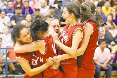 Glenlawn Lions players celebrate the team�s 54-42 victory over the Oak Park Raiders in the AAAA provincial high school championship game Monday at the University of Winnipeg Duckworth Centre.
