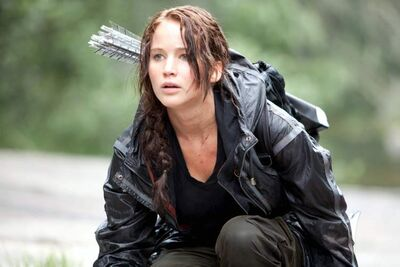 Jennifer Lawrence portrays Katniss Everdeen in The Hunger Games.