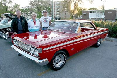 Fabulous 50's Ford Club of Manitoba president Albert Lannoo, far left, with wife Betty and club vice-president Adrien Poirier. The Lannoos recently completed a full restoration of their 1964 Mercury Comet. They have owned the car since 1967.