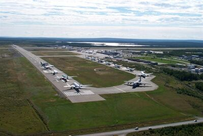 In this Sept. 12, 2001 photo provided by the Canadian government agency Nav Canada, planes line up on the runway of the Gander, Newfoundland, Canada airport after they were diverted to the remote town following the terrorist attacks on the United States on Sept 11, 2001. Thirty eight planes carried in 6,600 passengers. Residents took care of the stranded passengers for days and many of them have remained in touch with them since. (AP Photo/Nav Canada)