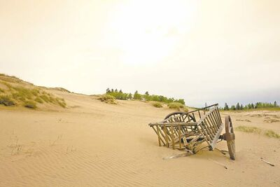 POSTMEDIA NEWSA weathered cart adorns a huge blowout bunker on the new Links Course at Alberta�s famed Wolf Creek Golf Resort.
