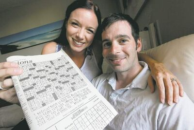 Rachael Hatherell and Daniel Minuk with the Cryptoquip puzzle in the June 30 edition of the Free Press in which Minuk hid his clever proposal to Hatherell.