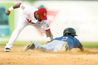 St. Paul's Adam Frost is tagged out by Goldeyes' second baseman Price Kendall Saturday night.