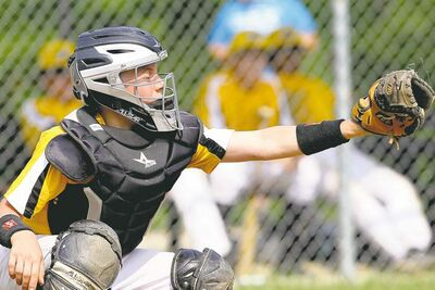 photos by tim smith / brandon sunABOVE: Team Winnipeg Gold catcher Victor Czerny shows where he wants the ball located. RIGHT: Team Westman�s Brody Smith slides into second to beat Team Winnipeg Gold�s Yvan Bourgeois in 14-and-under action.