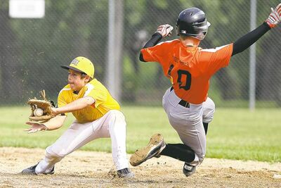 TIM SMITH / BRANDON SUNTeam Westman�s Brody Smith slides into second to beat Team Winnipeg Gold�s Yvan Bourgeois in 14-and-under action.