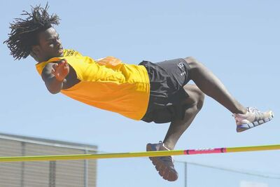 photos by COLE BREILAND / WINNIPEG FREE PRESSABOVE: Luxon Glor clears the bar in the high jump competition, taking bronze at the end of a day of first- and second-place medals in other Manitoba Summer Games events. LEFT: Glor could not catch Winnipeg Blue�s last  runner, but wins a silver for Team Winnipeg Gold just .53 seconds behind the 4x100 relay winner.