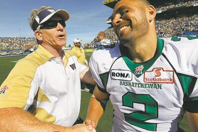 john woods / the canadian pressMoments after his FG seals the deal, Riders kicker Sandro DeAngelis shakes hands with Bombers head coach Tim Burke.