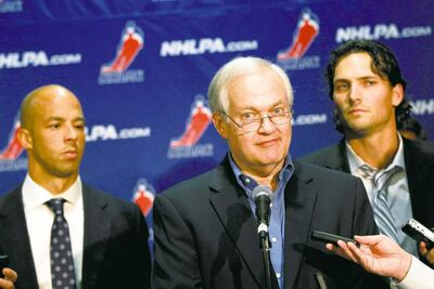 Jets defenceman Ron Hainsey looks on as NHLPA executive director Donald Fehr speaks to reporters in New York on Wednesday.