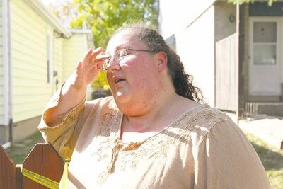 PHOTOS BY RUTH BONNEVILLE / WINNIPEG FREE PRESSKatrina, who lives in the Manitoba Housing complex in the 600 block of McGee Street, talks about her efforts to save one of the shooting victims.