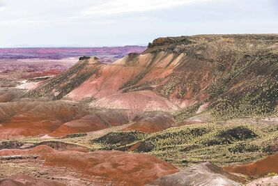 Sunrise at Nizhoni Point in Arizona, overlooking part of the Painted Desert. Erosion reveals different sediment layers, which are often different colors depending on the original sedimentation.