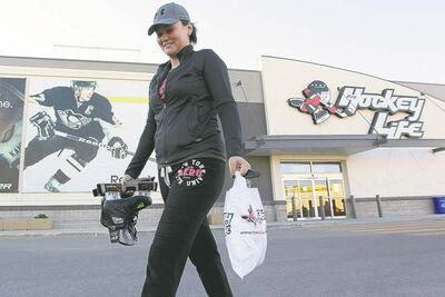 John Woods / Winnipeg Free PressKali Leary takes advantage of Sunday shopping and buys some hockey gear at a St. James store.