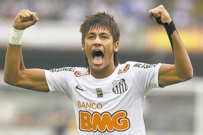 Santos' brilliant Neymar celebrates after scoring for Sao Paulo.