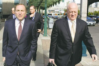 NHL Commissioner Gary Bettman (left) arrives with Assistant Commissioner Bill Daly for collective bargaining talks in Toronto on Wednesday October 16, 2012. Negotiations continue between the NHL and the NHLPA to end the current lockout. THE CANADIAN PRESS/Chris Young