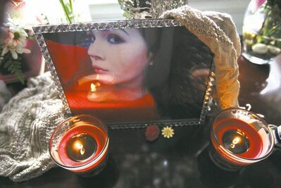 A photo of Julia Romanow, who died in the deadly crash on Nov. 1, 2012, sits on a table in her mother's home.