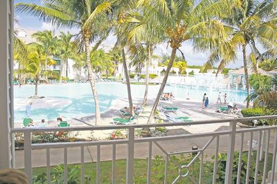 The pool area at the Tryp Peninsula resort is a magnet for sun-seekers. But watch out for falling coconuts.