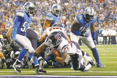 Rick Osentoski / the associated pressTexans running back Arian Foster crashes into the end zone during fourth-quarter action at Ford Field Thursday afternoon.
