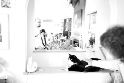 Mike Kane/Los Angeles Times William Braden (left) films Henry the cat with help from an assistant.