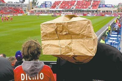 Chris Young / the canadian press archivesFans wore paper bags in protest of Toronto FC�s dismal record  during a 1-0 loss to D.C. United Oct. 6 in Toronto.