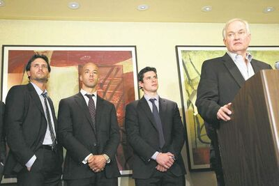 Mary Altaffer / The Associated PressRon Hainsey of the Jets, Vancouver�s Manny Malhotra and Penguins� Sidney Crosby (from left) listen as NHLPA executive director Don Fehr speaks to the media.