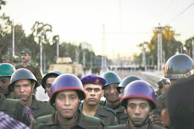 Egyptian soldiers stand guard during a demonstration in front of the  presidential palace Friday in  Cairo, Egypt.