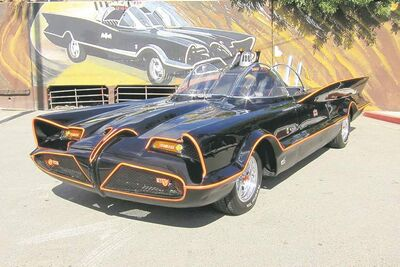 This October, 2012 photo, shows the the original Batmobile in Los Angeles. Batman's original ride, from the 1960s TV series, will be auctioned on Jan. 19, 2013, at the Barrett-Jackson auction house in Scottsdale, Ariz. The 19-foot-long black, bubble-topped car was used in the TV show that starred Adam West as the Caped Crusader. Famed auto customizer George Barris transformed a one-of-a-kind 1955 Lincoln Futura concept car into a sleek crime-fighting machine. On the show, it boasted lasers and a Batphone and could lay down smokescreens and oil slicks. (AP Photo/Courtesy Barrett-Jackson/George Barris)