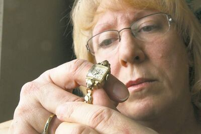 Sherry Winterburn holds a watch that was given to her that belonged to her great-aunt Edith Smallpiece.