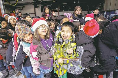 Around 150 kids from three Winnipeg School Division elementary schools, Strathcona, Mulvey and Dufferin, got to have lunch in the James Richardson International Airport's fire hall where Santa just happened to be testing out the STARS helicopter.